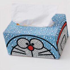 Blå servietboks med kasseansigt i diamond paint
