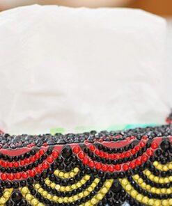 Servietboks med gule og røde buer