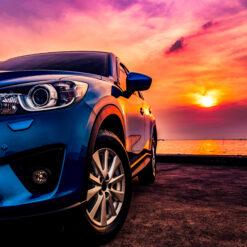 Blå bil ved solnedgang i diamond paint