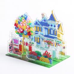 3D-billede af balloner foran hus